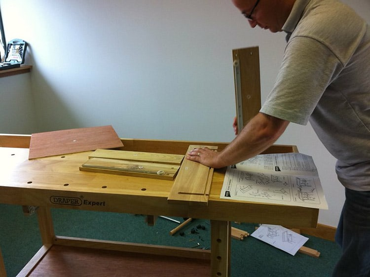person using a woodworking bench