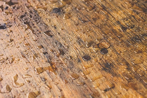 Wood surface with water droplets