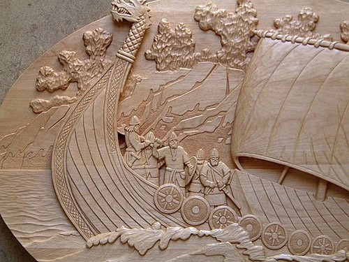 Viking ship wood-carved relief