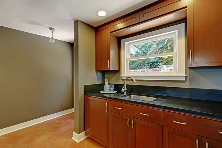 Kitchen mahogany cabinets with a sink. House interior