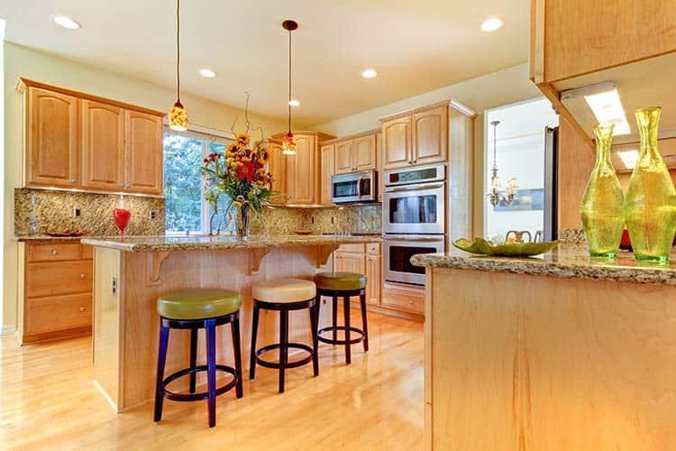 Large luxury maple wood kitchen with island and stools