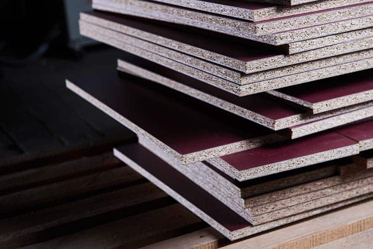 Set in the manufacture of chipboard in low light