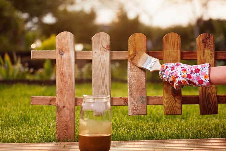 varnishing-the fence