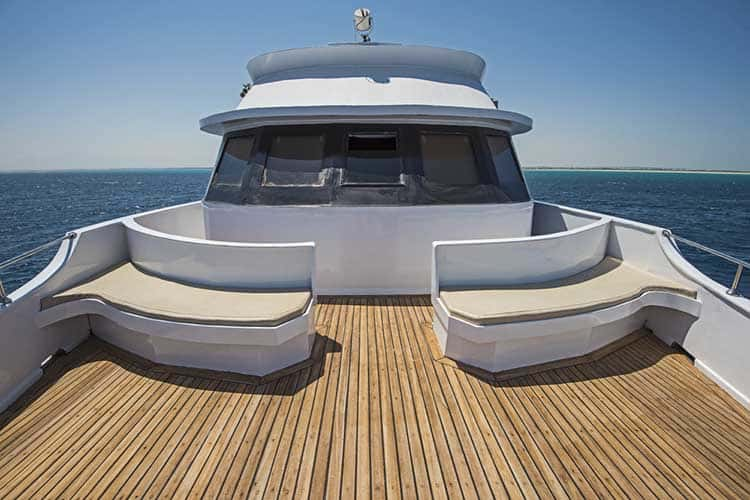 View over the bow over a large motor yacht