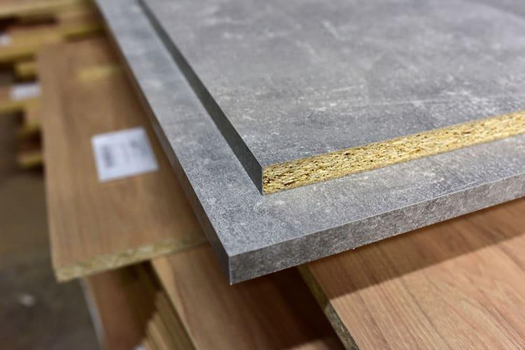 Fragment of a wooden panel made of fiberboard in workshop. Mediu