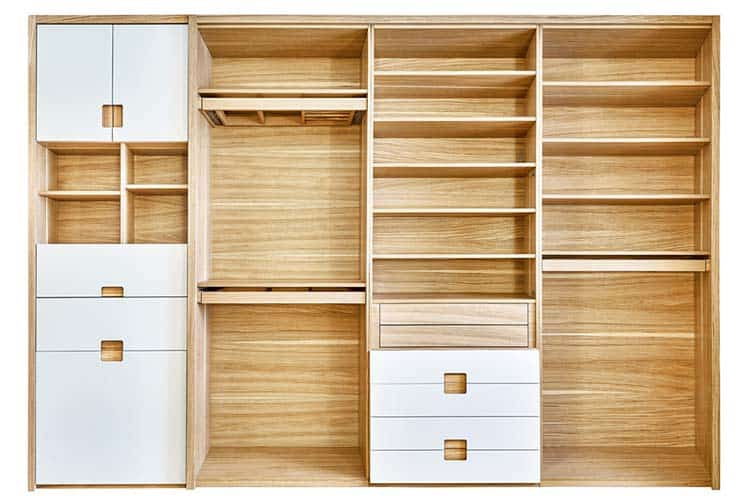 Modern wardrobe with empty shelves isolated on white background. Wooden wardrobe with light gray cabinet doors