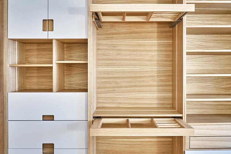 Modern wardrobe with slide out rack for coathangers. Detail of modern furniture