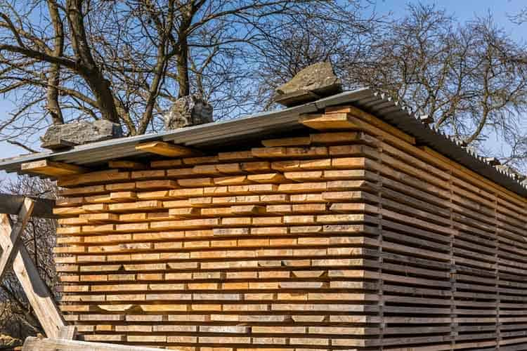 Wooden planks and beams. Air-drying timber stack. Wood air dryin
