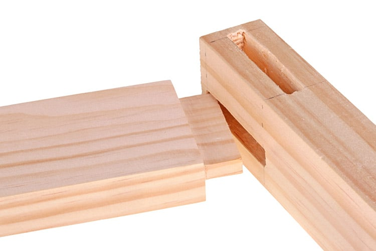 Close-up of boards with woodworking tenon inserted into a mortis