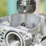 Tapping automotive part by cnc machining center