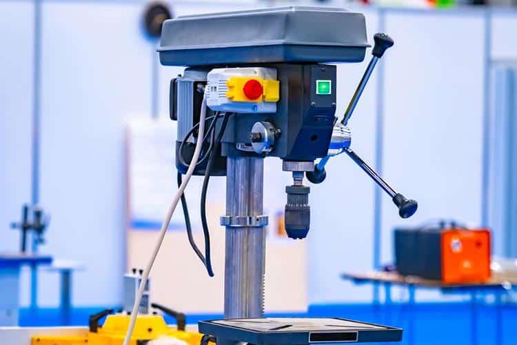 Vertical drilling machine close-up. Drill press with a vise. Equ