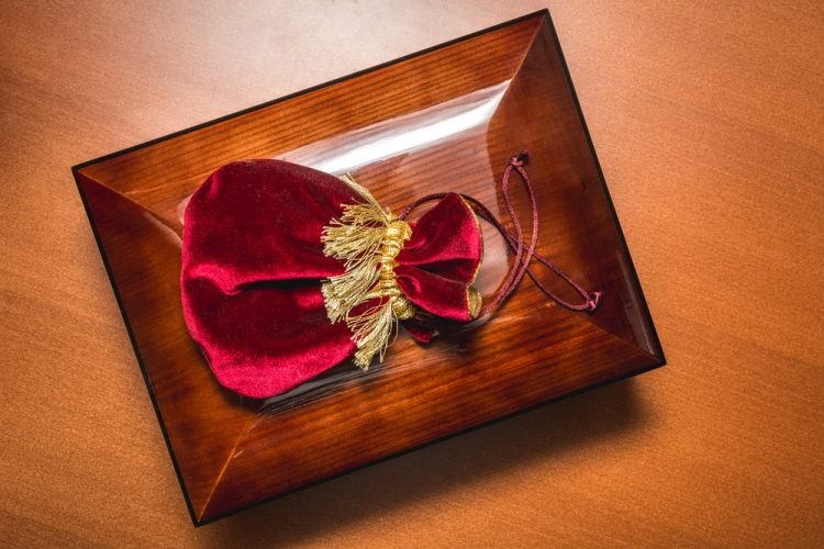 A rich red pouch of tobacco and Spanish cedar humidor