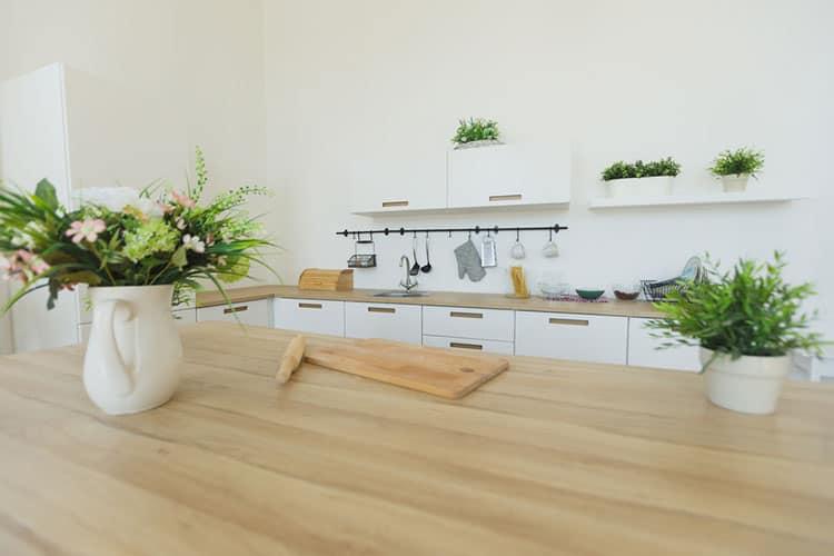 Interior view of elegant minimalist kitchen and dining area.