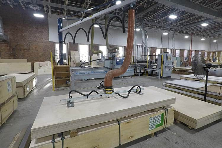 The Computer Numerical Control (CNC) Nesting Router is used for cutting and nesting batches of parts for the Baltic Birch plywood