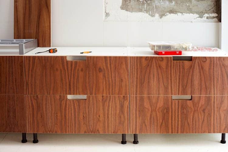 construction of interior design modern kitchen in walnut wood